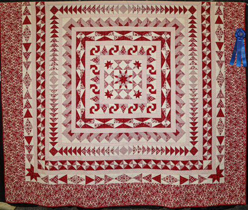 seeing red and red again by valerie peters, artisan division two-person large pieced, dallas quilt show 2020