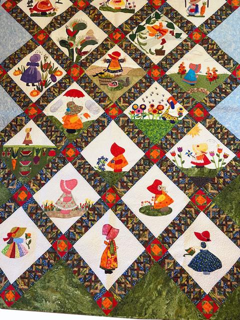 keeper quilt, sunbonnet sue and her garden